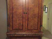 Beautiful traditional armoire with marble accent and