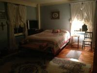 We have a furnished (or unfurnished) room for rent in a
