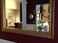"Mirror with beveled glass measures 34"" x 48"". In"
