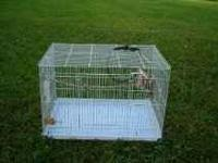 Large Bird Cage for sale. Almost new. 23Wx16Hx16D Call