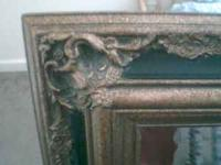 The frame is black & gold very heavy mirror requires D