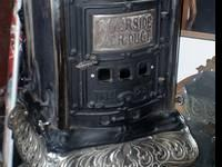 ANTIQUE CAST IRON PARLOR STOVE If you're looking for an