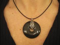 Large onyx stone held by a sterling silver Celtic