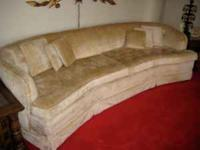 Unique curved couch that seats 6 people. Creamy yellow