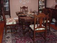 Double pedestal wood table with 8 chairs. The table has