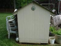 Large dog house. 47 3/4 inches x 49 x 66 1/2 high. Has