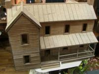 Large, rustic wooden dollhouse. Measures