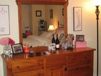 Dresser and matching mirror for sale. It is solid wood