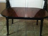 Large Ethan Allen dining table. Has three leaves to