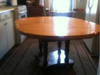 Very nice older solid maple dining table with two