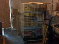 Large white ferret cage with shelves and bottom tray.