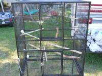 Have a big bird cage on wheels. Bars are tiny