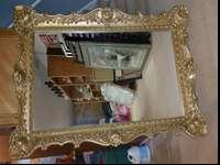 Beautiful antique ornate mirror measures 57x34, $350