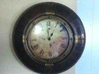 large leather clock about two feet wide very beautiful