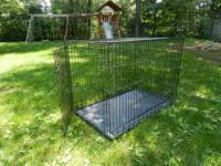 Super dog crate with removable metal bottom for