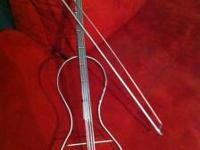 Handmade iron violin w/ bow painted silver. Piece is