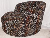Big Milo Baughman swivel lounge chair.Upholstered in