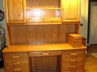 This is a large used oak desk with hutch in excellent