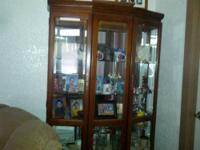 Large Oak Curio cabinet- not pressed board. It has a