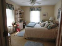 Lovely room completely furnished in pastels with