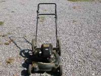 YARD MACHINE PUSH MOWER, 4H.P. BRIGGS AND STRATTON