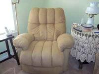 I am selling a large stuffed beige colored recliner.In