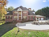 Situated on three+/- acres, this four-sides brick home