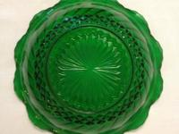 I have a Large Set of Vintage Green Glass Bowls with a