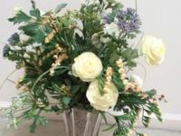 Selling a large silk flower arrangement blues and