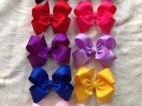 For sale are large solid colored hairbows on sale