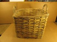 A large woven basket. Its 16 X 16 inches square and 13