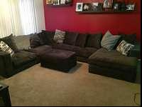 This is a very large charcoal sectional. It has 4