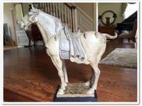 This is a large Tang horse in aged ivory color by
