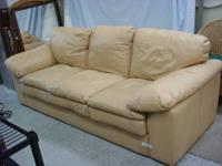 Big three-cushion leather couch in a butterscotch tan