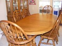 This is a beautiful American Oak dining room set for