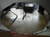 LARGE MIRROR: ..unframed mirror with curved edges to be