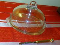 I have for sale a large vintage glass cheese dish with
