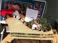 BIG WICKER SLEIGH ... 29 L/ 21H/ 15 W. LIGHTS UP,