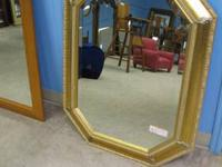 Large Beveled Mirror in a wood frame which is currently