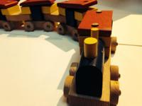 Selling a handmade wooden trains with six cars and an