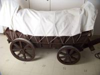 Here is a large wooden covered wagon. This wagon is