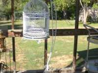 Large wrought iron birdcage with stand. 75.00