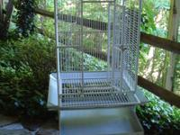 This wrought iron, powder coated metal bird cage comes