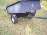 Large metal yard trailer. has new bigger heavier tires.