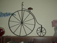 This is an antique bicycle meant to stand on a shelf,
