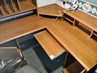 10 foot wooden desk in two sections, 26 inches tall at