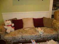 Large Floral sleeper sofa with many throw pillows. In