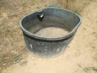 Large tough plastic black water trough with self
