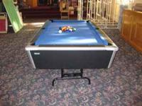 Large, sturdy pool table. Table top is in very good