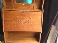 We have for sale a very good oak secretary/desk. It's